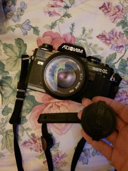 minolta camera with lense and strap
